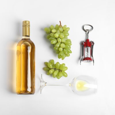Composition With Wine And Grape On White Background, Top View