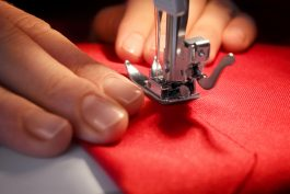 Woman,Sewing,On,Machine,,Closeup